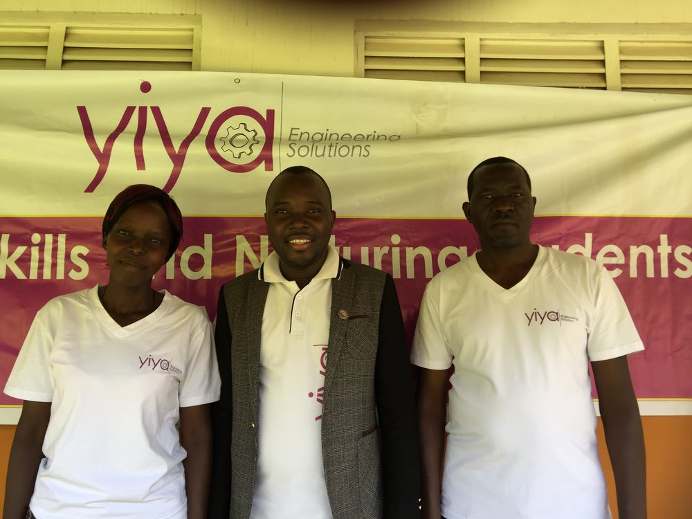 Yiya teachers at ST. Katherine take a photo with Yiya project director.JPG