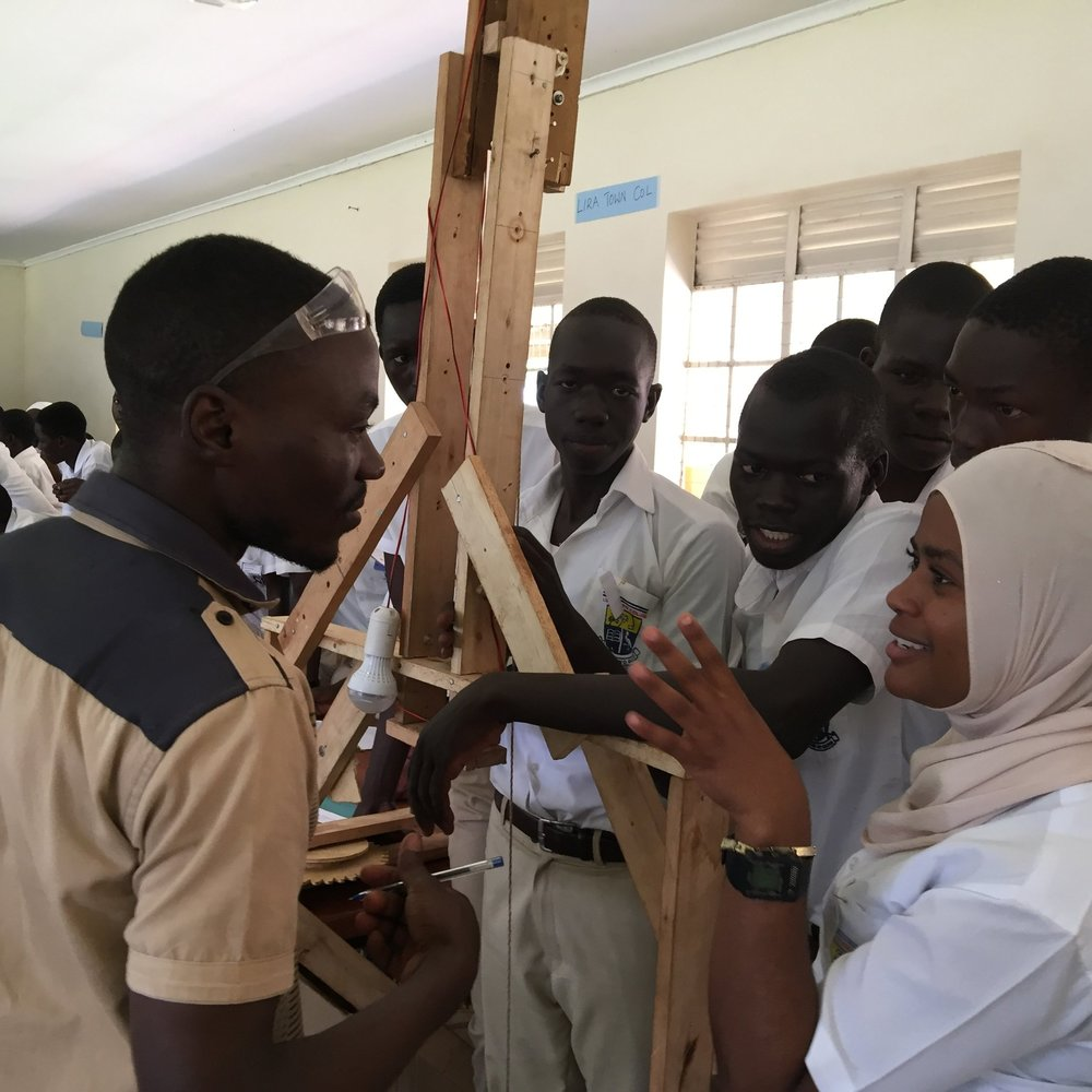 A student explains how they made their gravitylight.JPG