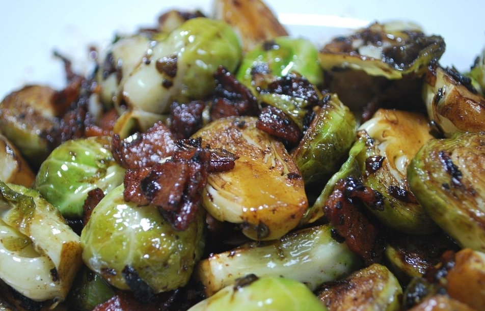Maple Roasted Brussel Sprouts - 1 Pound of trimmed and sliced Brussels sprouts1/4 cup Extra virgin olive oil3-4 tablespoons of pure Vermont maple syrup, Grade: Amber/rich flavor4-5 slices of bacon cut into 1/2 inch stripsSalt and pepper to tastePreheat oven to 400 degrees FPlace Brussels sprouts in a large bowl and toss with oil and syrup until completely coatedAdd bacon, salt and pepperPlace contains in a roasting pan and place in the ovencook for 20-25 minutes, remove and stir sprouts quickly, and place back in oven for an additional 20-25 minutes until bacon is completely cooked and Brussels sprouts are caramelized