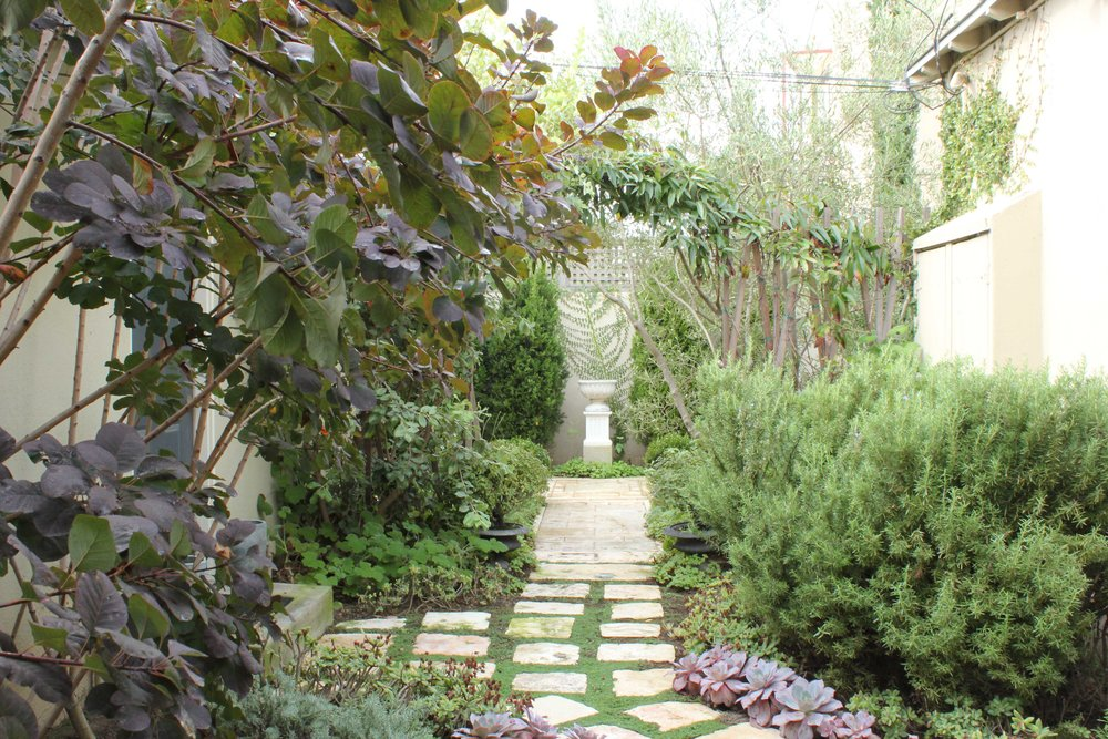 Sterling and Gregory's backyard photographed by Emily Green on Oct. 29 in Santa Monica. Design by Dryden Helgoe