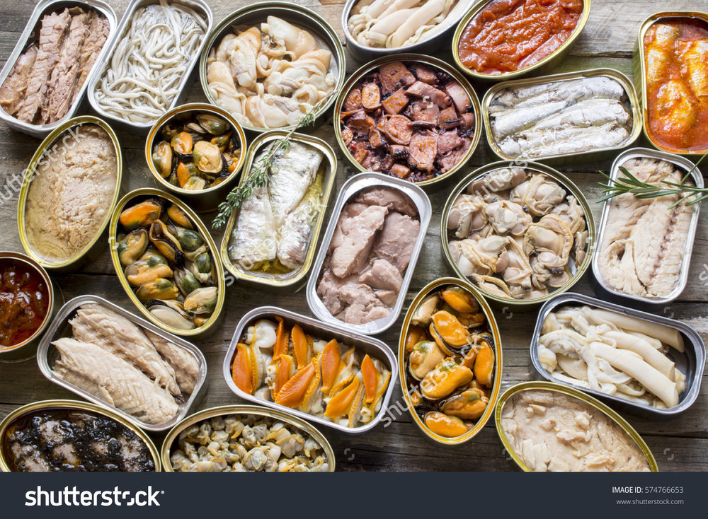 stock-photo-assortment-of-cans-of-canned-with-different-types-of-fish-and-seafood-574766653.jpg