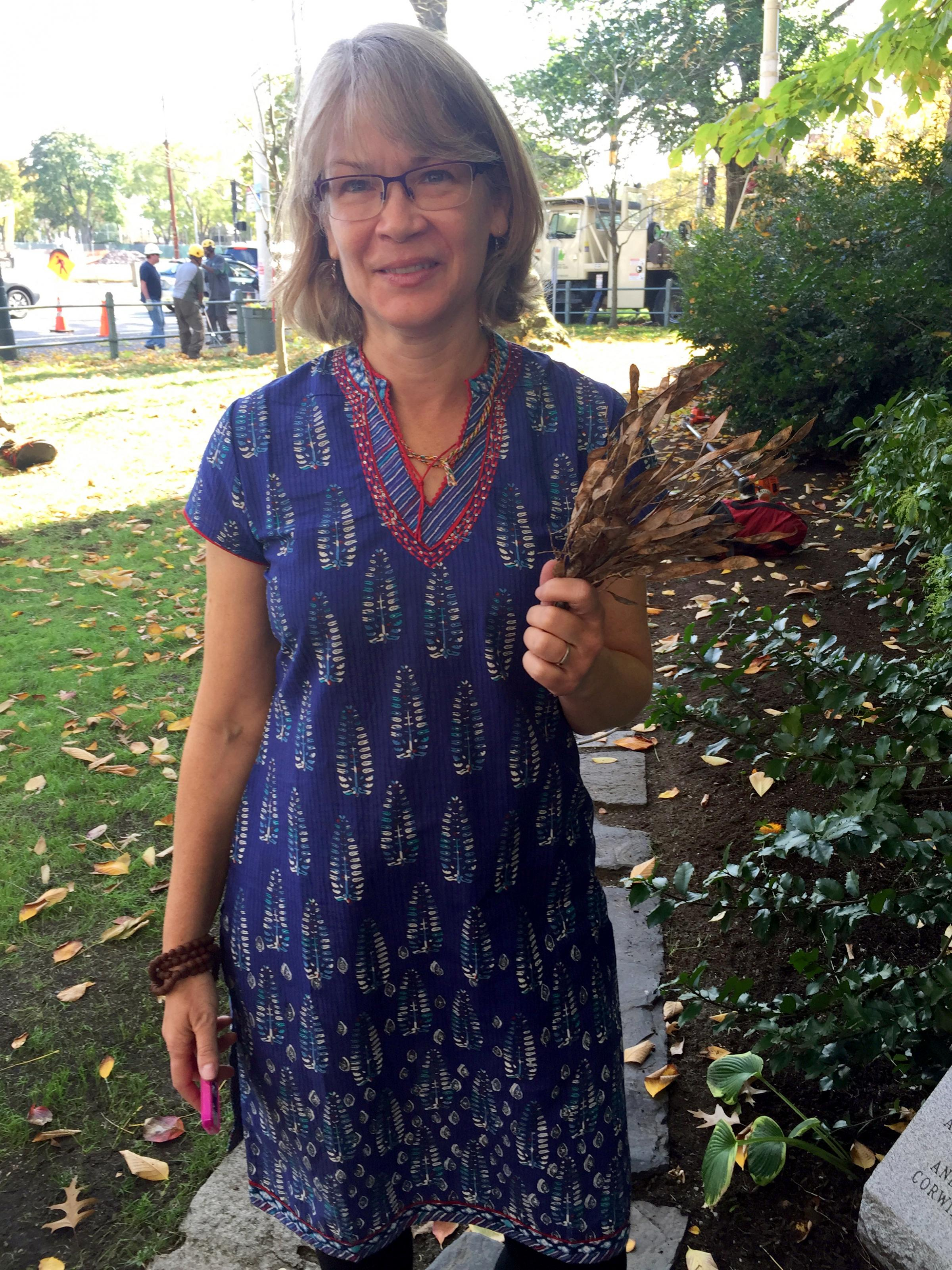 First Church minister Karen Case collected seedpods that will be shared with Arnold Arboretum and Mt. Auburn Cemetery. (Edgar B. Herwick III WGBH News)