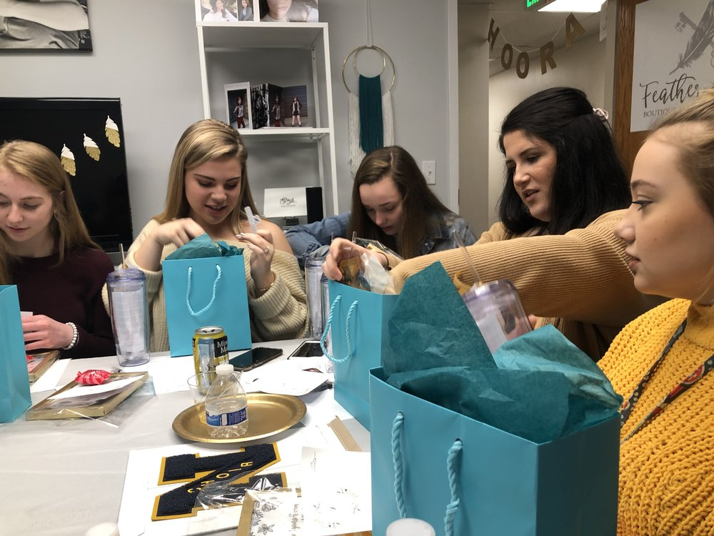 The 2019 Dream Team opening welcome gifts at the feather & key studio in Huntington