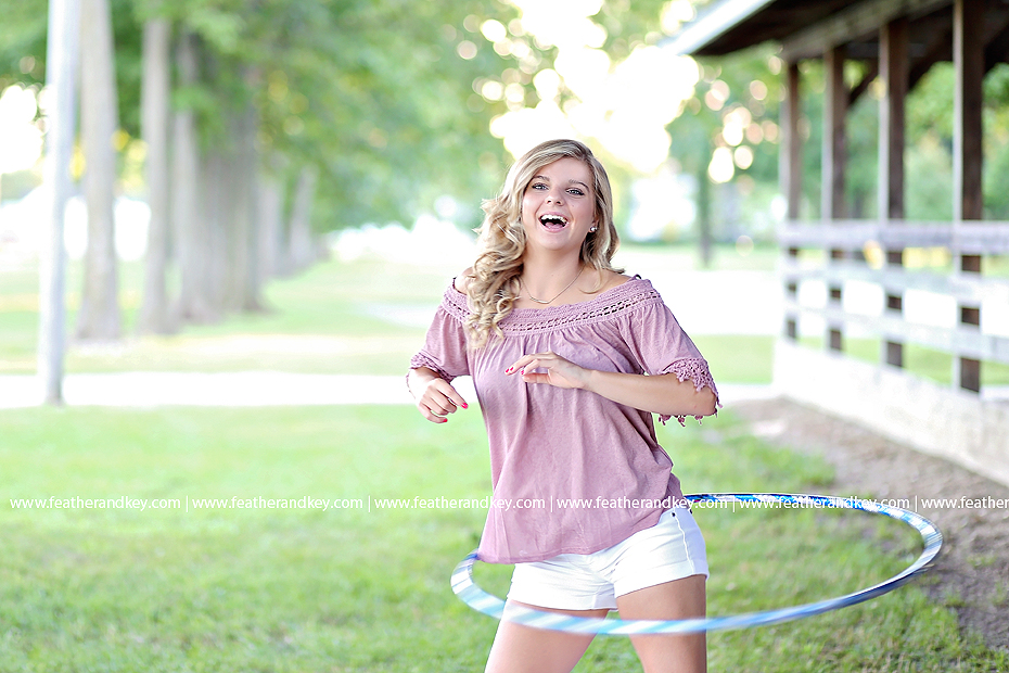 HNHS senior Josie hoola hooping at the heirs park fairgrounds for a summer themed photo shoot with feather and key photography.