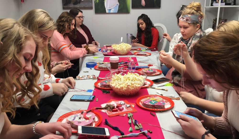 The feather and key dream team making friendship bracelets for our galentines day random acts of kindness project
