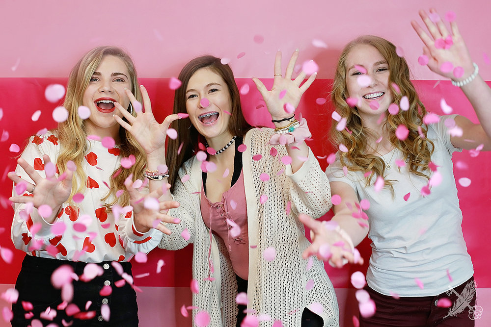 HNHS students throw confetti at the photographer in the feather and key studio in huntington, IN