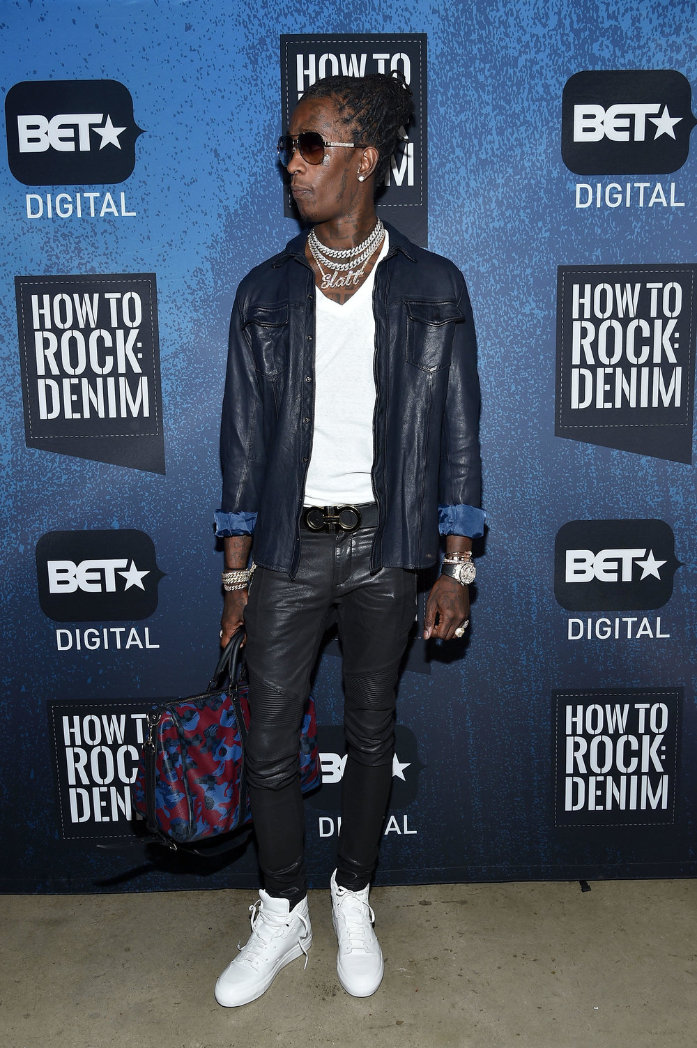 Young Thug sporting a purse.