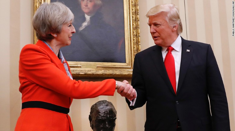 Pictured are May and Trump.  Photo via CNN.com