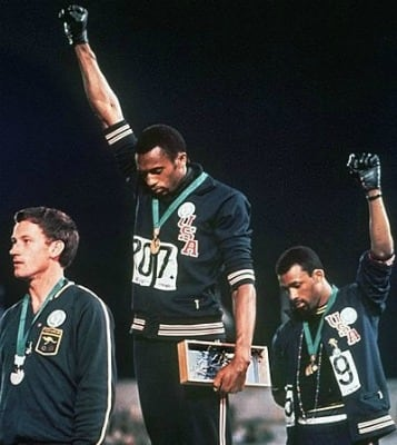 Tommie Smith and John Carlos protesting at the Olympics in 1968. Photo via Complex.com.