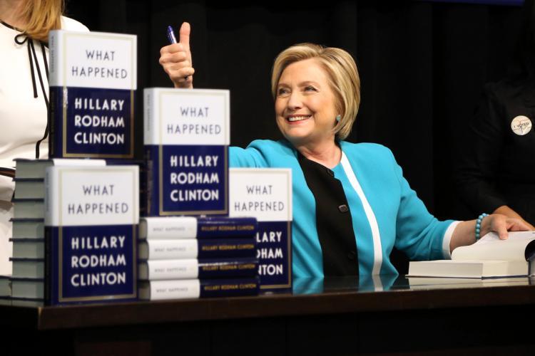 Clinton at a book signing, photo via  Slate