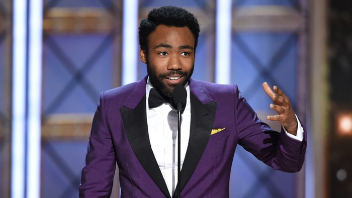 Donald Glover accepting his reward, photo via  Rolling Stone