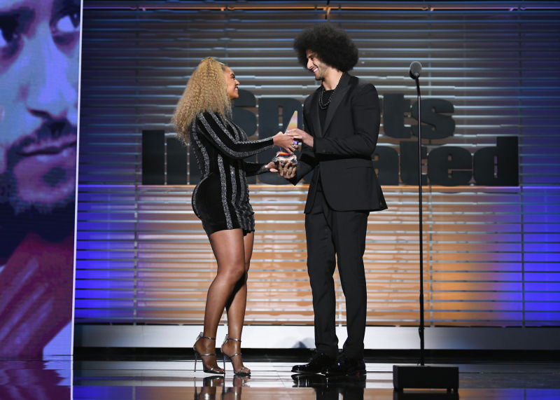 Beyoncé presenting the award to Colin Kaepernick, photo via  Getty Images
