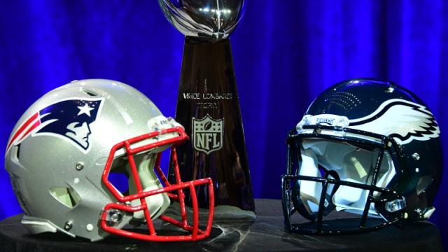 Patriots and Eagles helmets. Photo via Wordpress.com