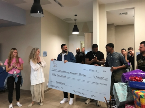 Drake presenting to the check to the Lotus House Women's Shelter, photo via  TMZ
