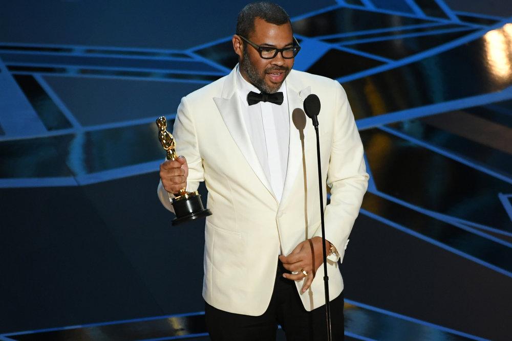 Jordan Peele accepting his Oscar, photo via  NBC