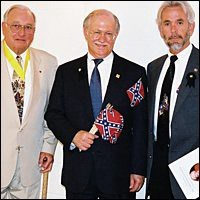 Parker holding a Confederate flag. Photo via ThinkProgress.org