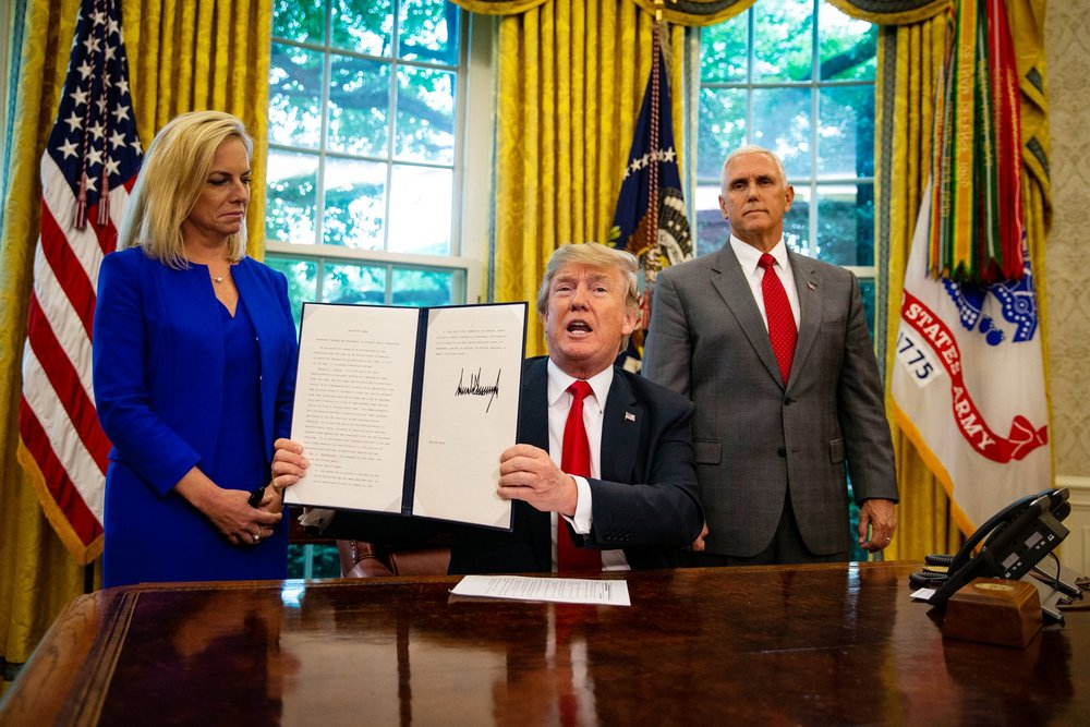 Trump signing today's executive order, photo via  New York Times