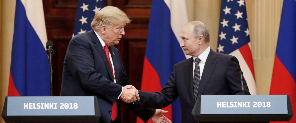 Trump and Putin shaking hands, photo via ABC News