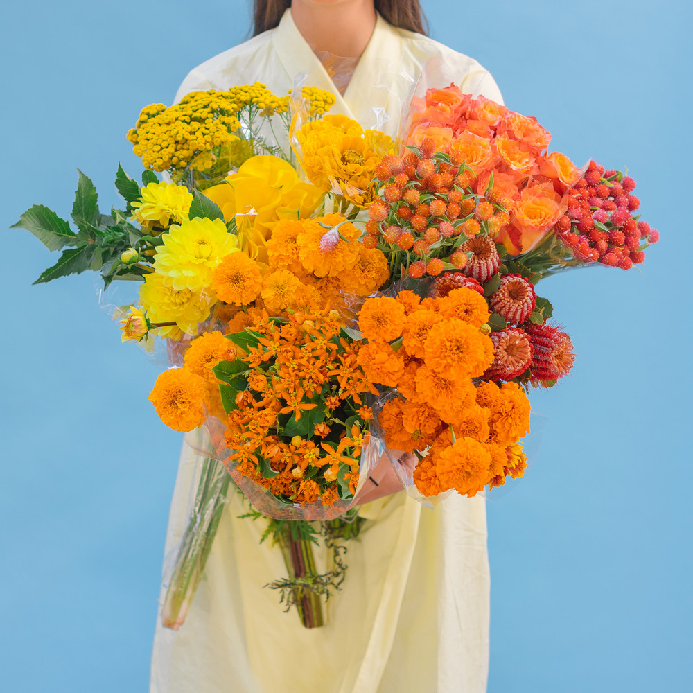 the-easiest-way-to-make-any-flowers-look-expensive-ombre-yellow-floral-59c57dd91c2f5d146a42e733-w1000_h1000.jpg