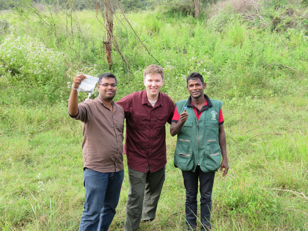 Another successful fecal collection. Left to right: Sachintha, Chase, and DWC tracker Nawa. Photo: Wendy Kiso.