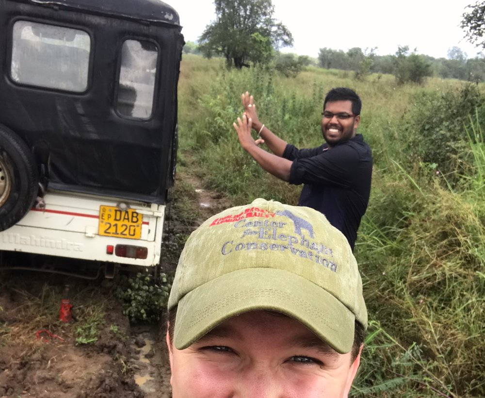 Waiting for our rescue vehicle to come. Not sure if Sachintha thinks he's using some sort of force field to will the car out of the mud hole.