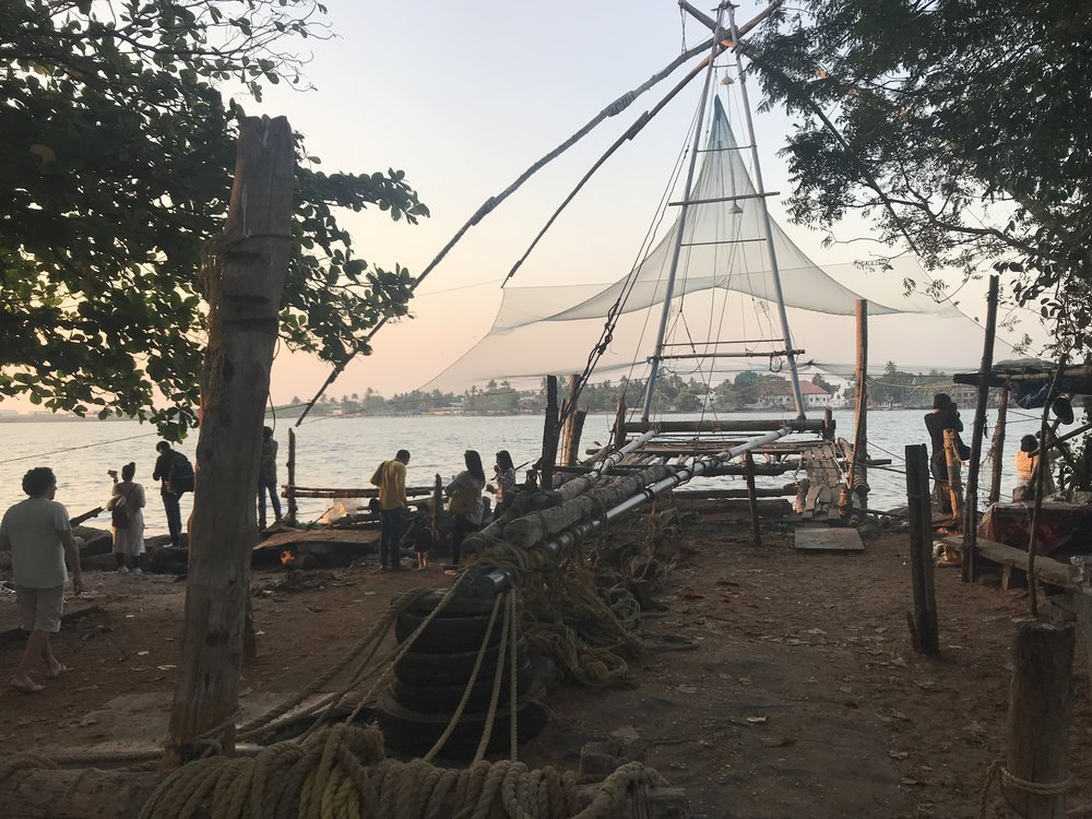 One of the Chinese fishing nets from the back. The net is perfectly balanced, so that a person walks along the length of the beam to dip the net into the water, and then after a bit, a team of fishermen use ropes to bring in the catch.