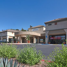 GREEN RIVER PROMENADE  40,000+ sq' neighborhood center. Acquired at 30%occupancy. Cured functional obsolescence of a former six screen theater, attracted new anchor and leased asset to 100% occupancy. Carved out two separate parcels for additional development or sale.