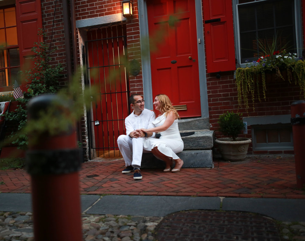 Couple sitting in Elfreths Alley during their love photo session