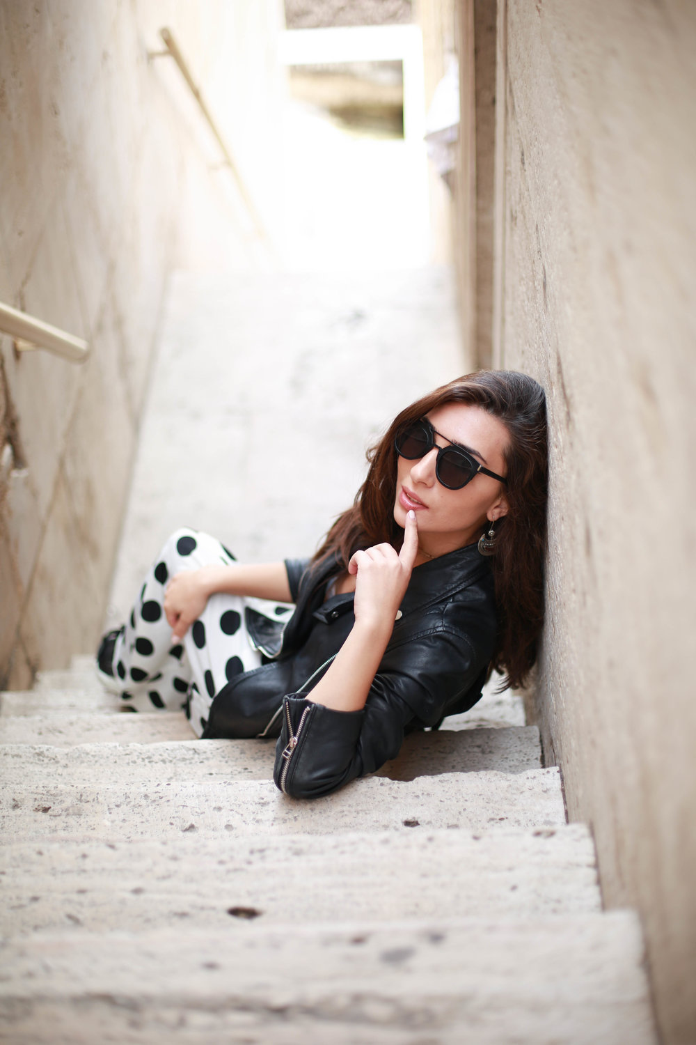 Polka dot skirt and black jacket portrait