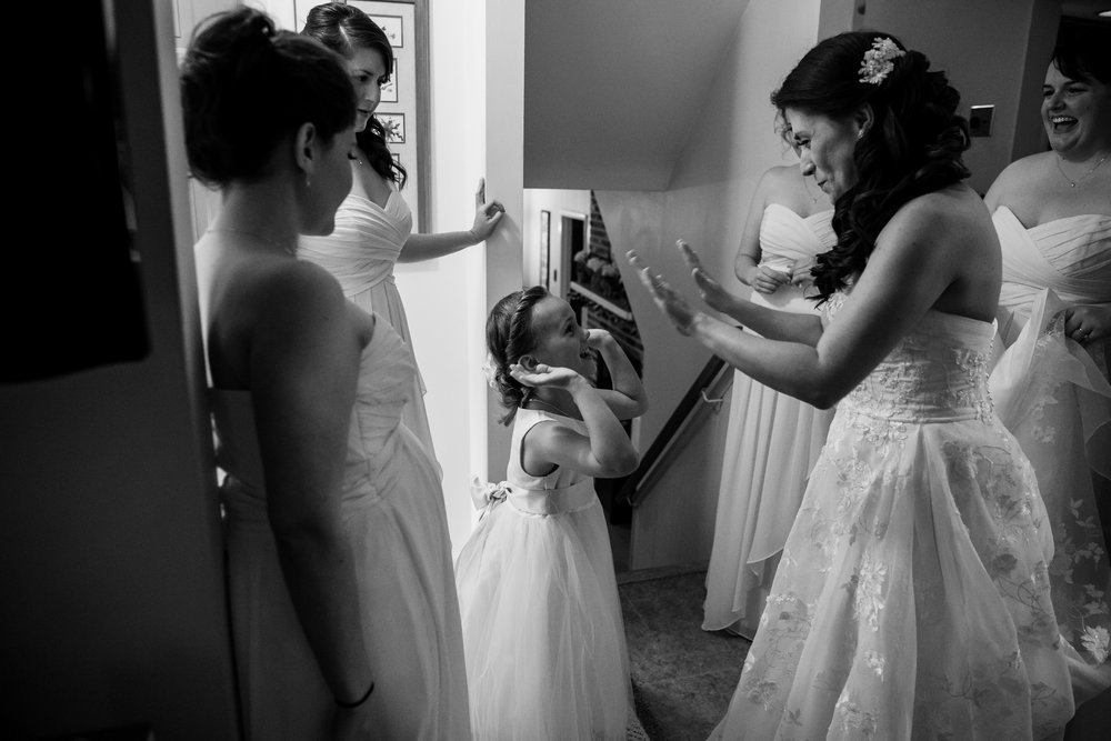 Bride high- five flower girl