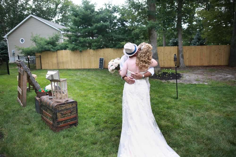 first look backyard wedding