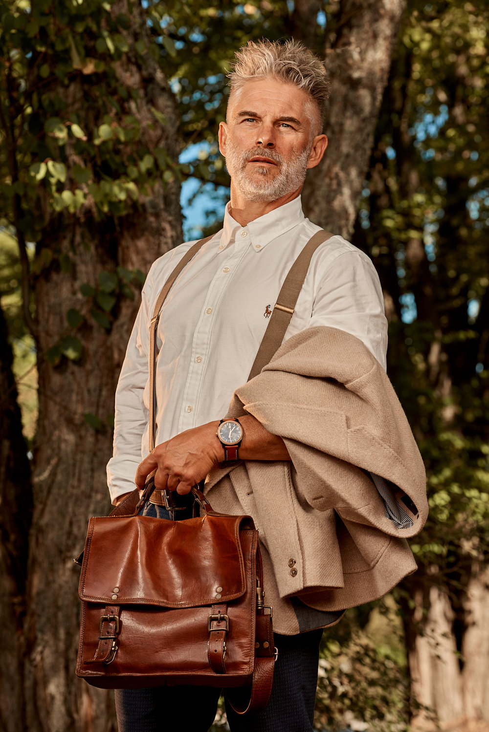 Suspenders: Ralph Lauren - White Dress Shirt: Ralph Lauren - Blue Chino Pant: Ted Baker -  Leather Band Watch: Fossil - Pocket Square: Moschino - Wool Coat: Black Brown 1826 - Brown Leather Boot: A.S. 98 - Brown Leather Satchel: