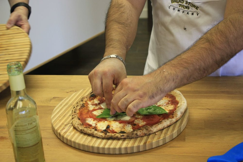 Adding Basil to Margherita Pizza - Pizza Class - Bread Stone Ovens.jpg