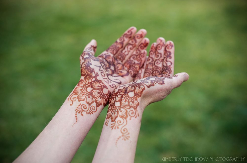 Natural henna stains vary greatly depending on the skin thickness and location, body chemistry and other factors. Here, Audrey is wearing natural henna on her palms. The deep rich stain is typical on palms because of warmth & thicker skin layers. Henna paste was applied and remained on the palms overnight. This stain is 24 hours old, typical stain development takes between 24-48 hours. (Photo by Kimberly Teichrow Photography, Henna design & application by Allison Dickerson, Allura Henna).