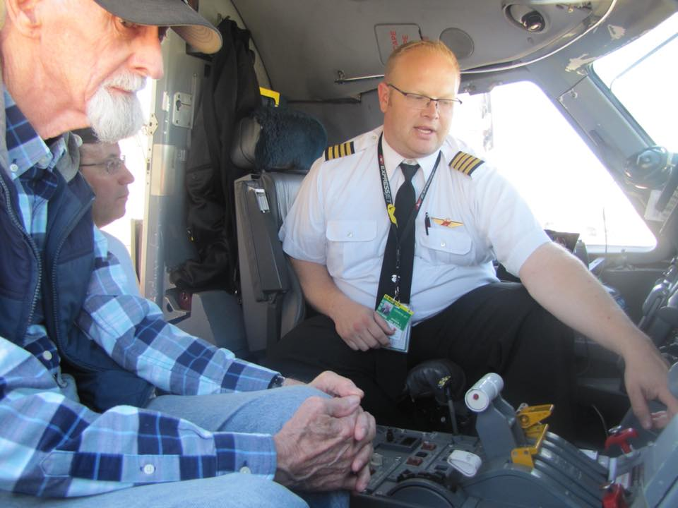 Bill Havener (left),    Airport Hall of Fame    Member, and Craig Woodley of    Woodley Aerial Spray   , look on as ExpressJet Airlines Chief Pilot of Chicago O'hare Domicile, Captain Drew Wilkens, explains some features of the Embraer 145 passenger jet during the 2017 Aviation Career Day and Airport Open House.
