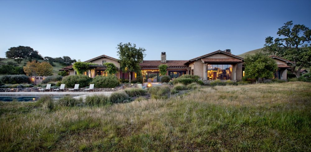 An overview of the expansive home and pool area.