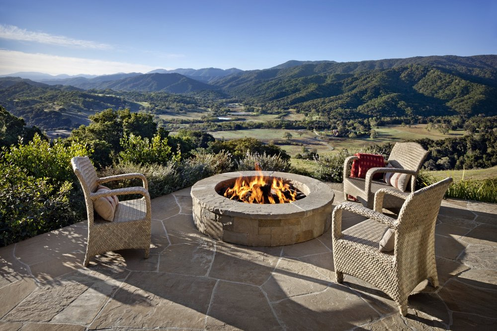 The firepit is close to the ridge, with sweeping views of the valleys below.