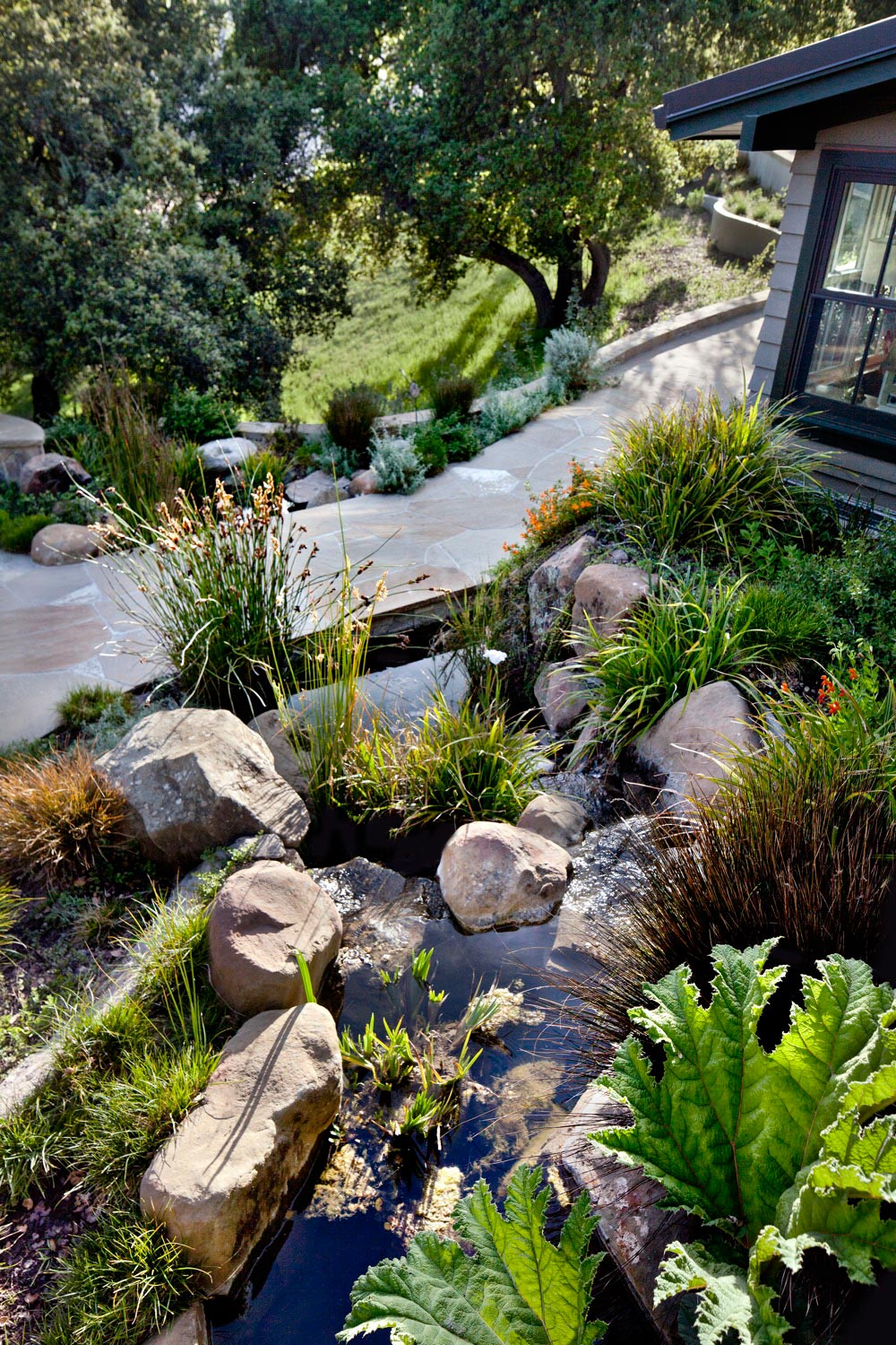 The naturalistic water feature reads as a stream, providing a very gentle sound of water.