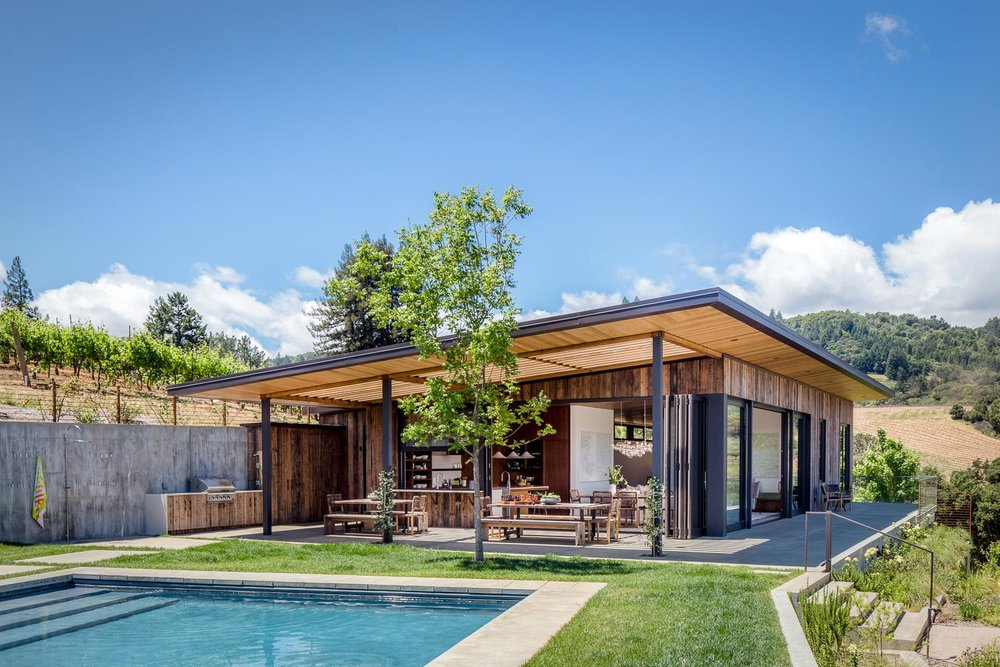 The main terrace includes a pool, outdoor shower, and an outdoor kitchen and dining area.