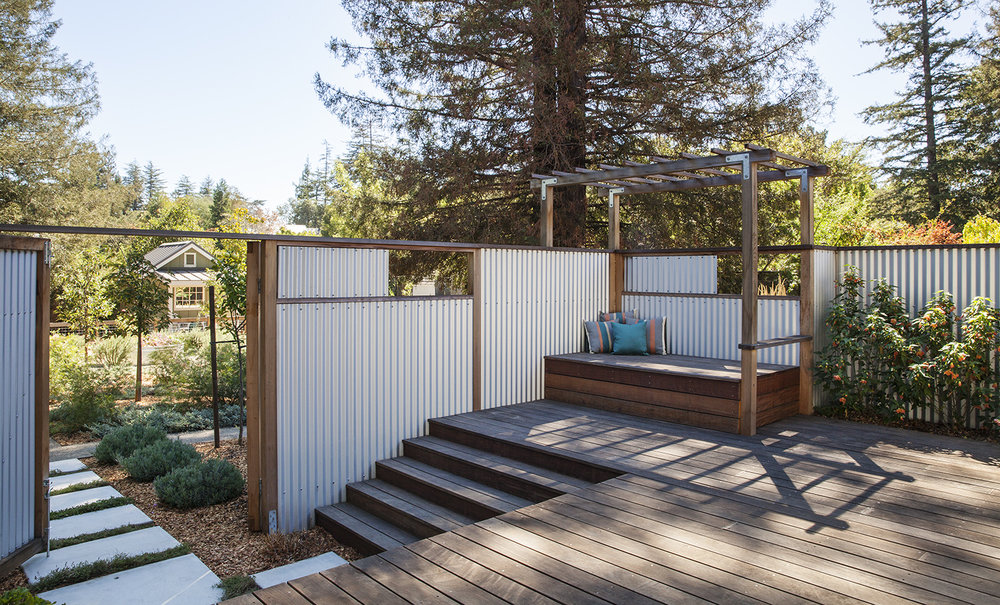 The master bedroom patio closes off for a private seating area. Aluminum panels slide open or closed for additional privacy.