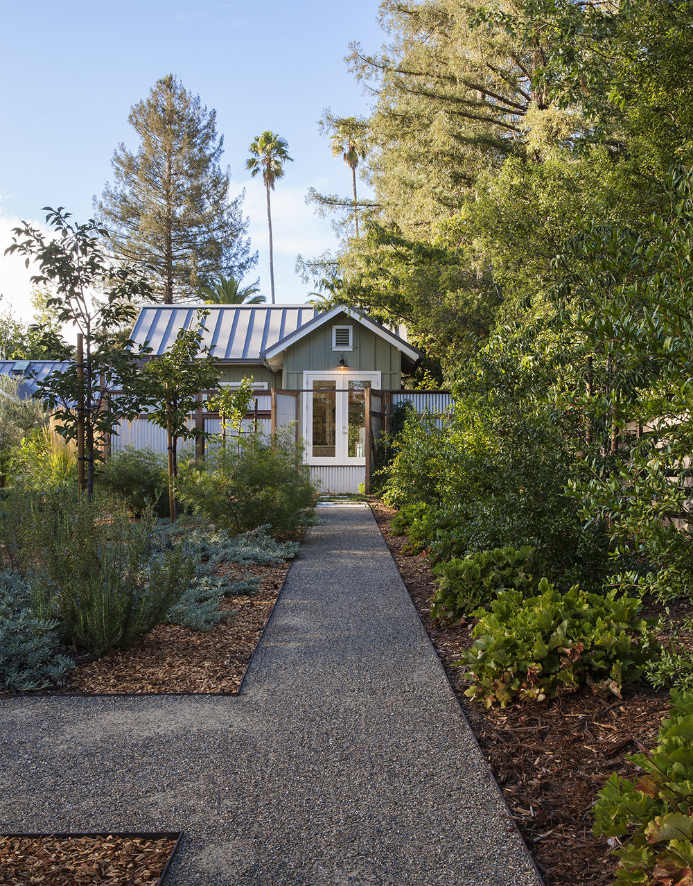 The gravel path is pleasantly crunchy to walk on, and leads up to the master bedroom patio.