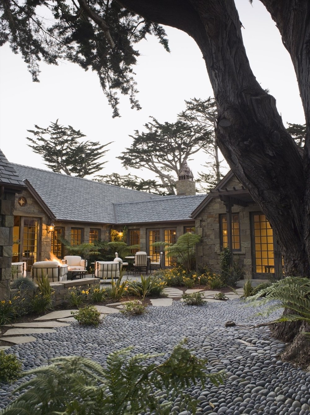 In a courtyard, paving created from large, smooth pebbles provides an unusual tactile texture.