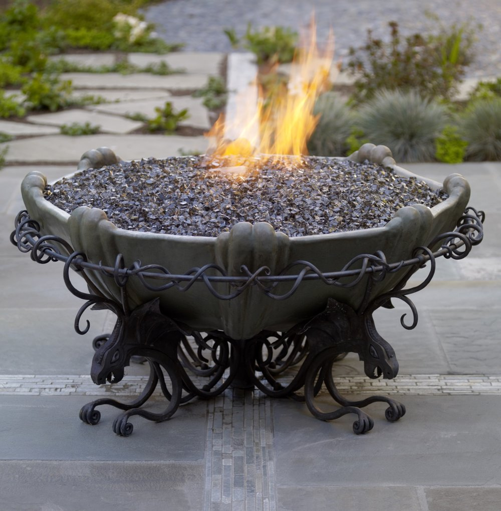 The firepit features dragons, a nod to the narrative tale of the landscape.