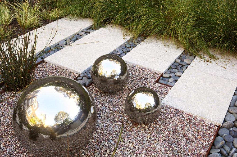 Reflective metal balls are a sculptural element.