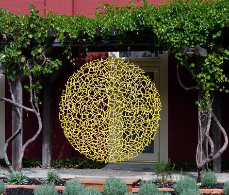 "Ivan McLean's sculpture ""Yellow Disk 78"". Image courtesy of Sculpturesite"