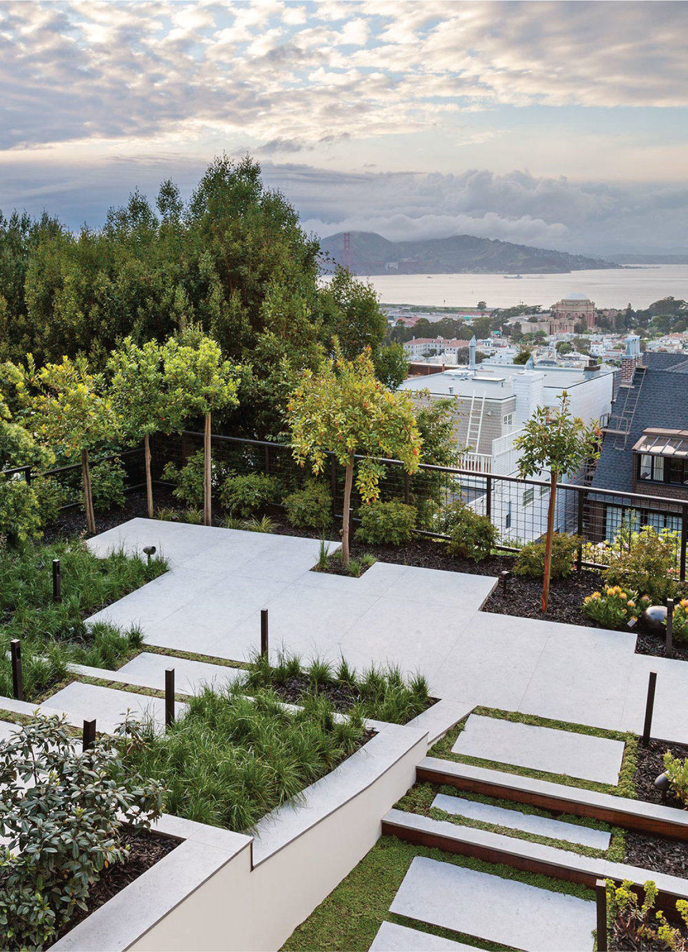 The view from the balcony towards the Palace of Fine Arts and across the bay is enhanced by the garden geometry.