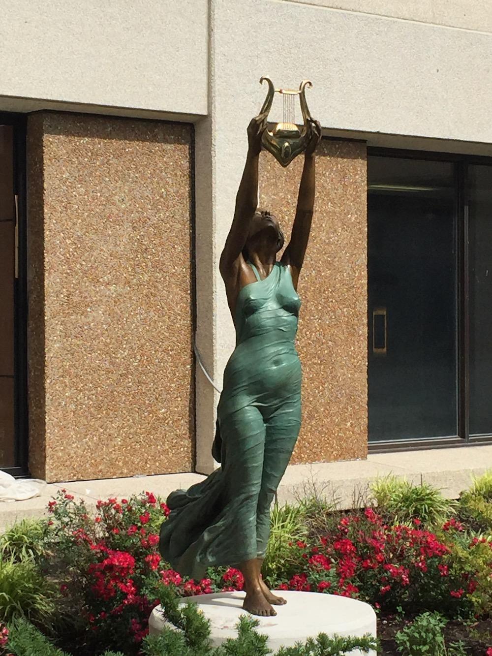 Euterpe's Gift  -6'9 X 41 X 27 in cast bronze (2016) on campus of IUSB