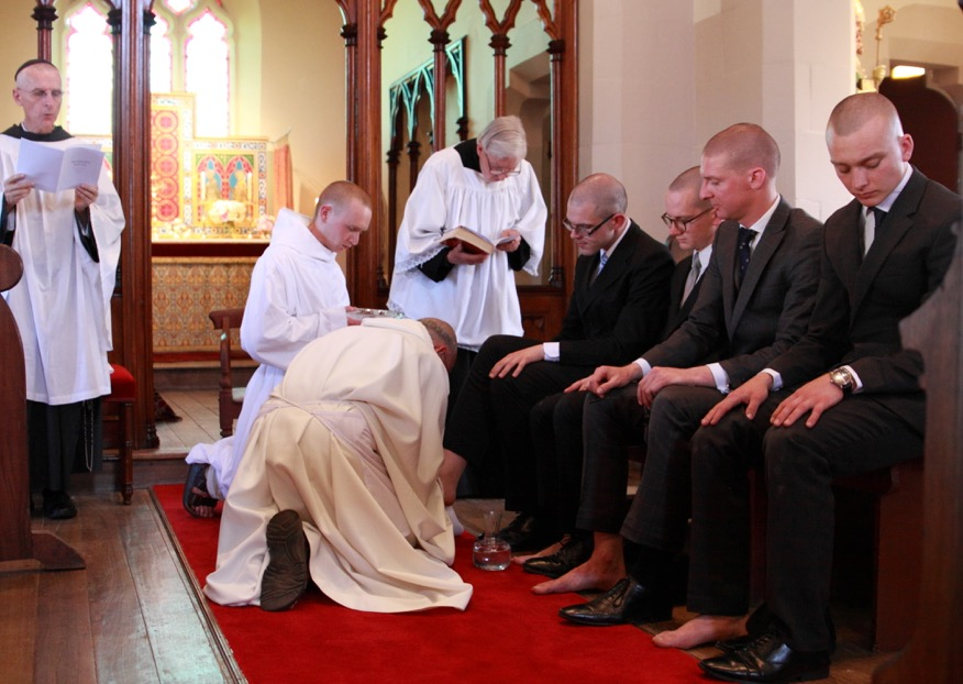 Father Prior washes the feet of the to be clothed postulants.