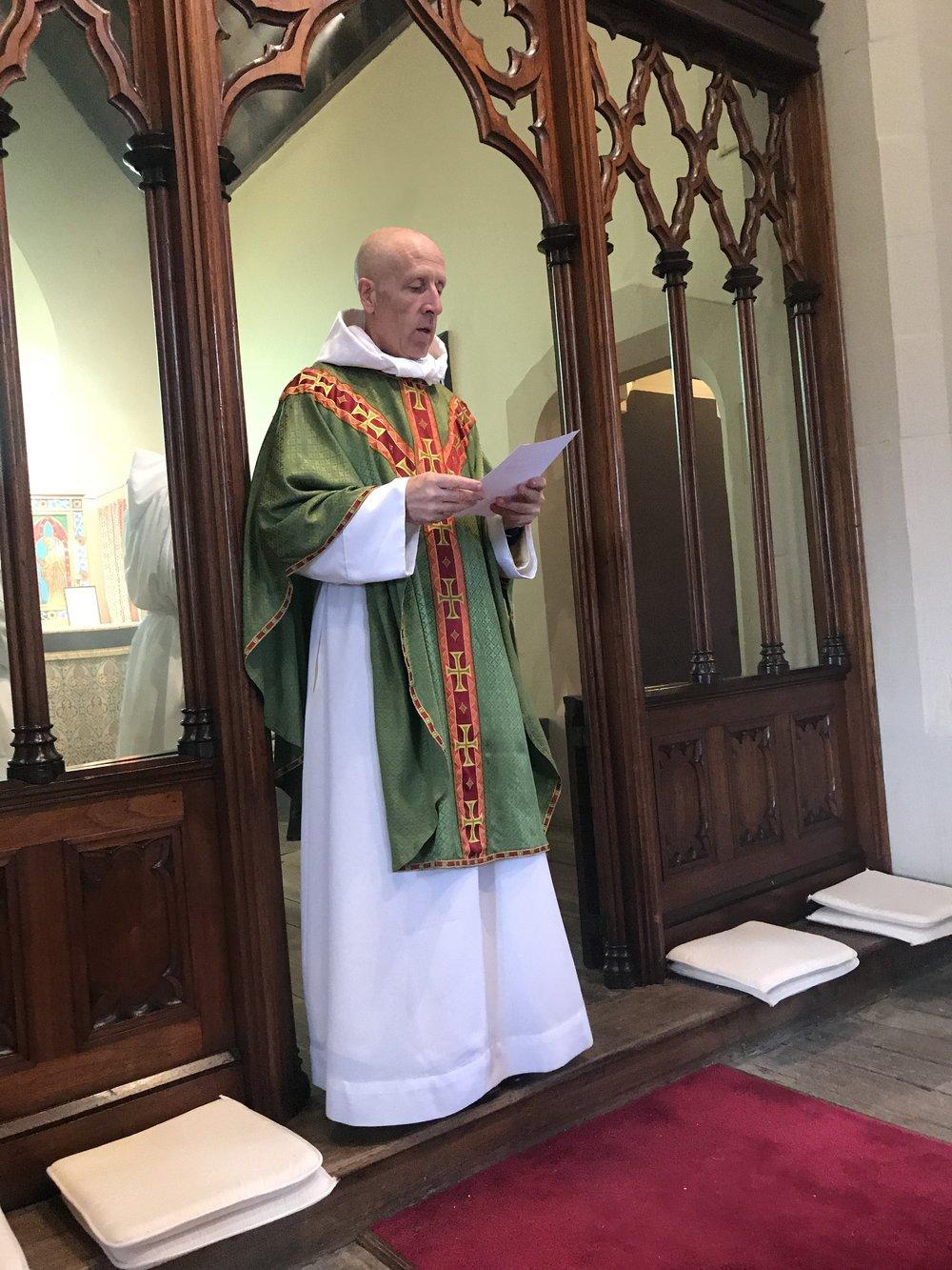 Fr Bachmann preaching at Sunday Missa Cantata