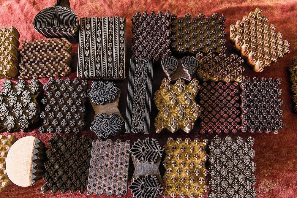 A grouping of blocks, chiseled by specialized carvers, in traditional patterns. Each color requires a separate block. Credit, Abhishek Bali